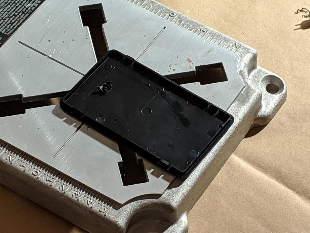 Enclosure lid on a drill press base